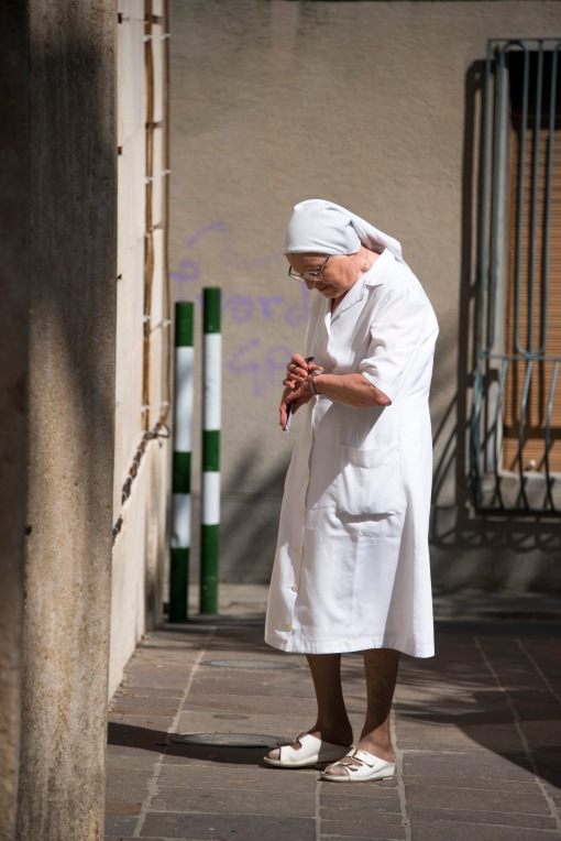 _DSC2877  Alassio  Italy DevotionNun in allassio checking her watch